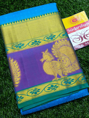 Pure kanchiPuram silk saree comes with over all body flower embose design with multi design gold border