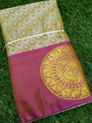 Half silk saree comes with over all body small coinembose design with gold round peacock butta border