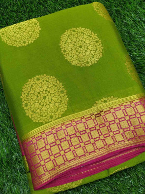 Chiffon saree comes with over all body round gold flower butta design with checks butta border