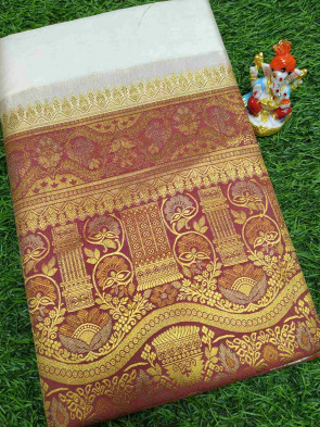 Art silk saree comes with over all body plain design with multi design gold small border