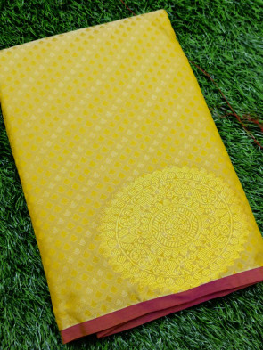 Art silk saree comes with over all body small tiny flower embose design with round big gold flower butta border