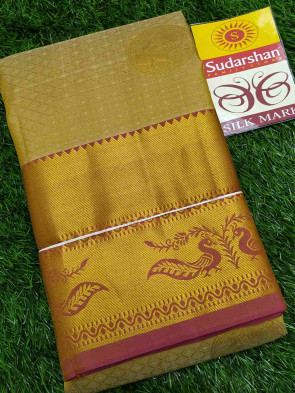 Kanchipuram silk saree comes with over all body round gold jeri flower butta design with multi design gold jeri border