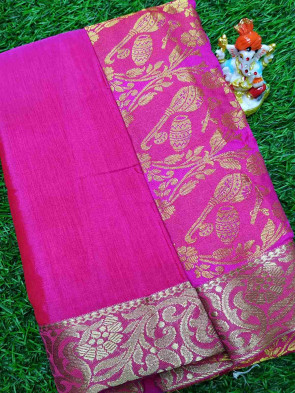 Raw silk  saree comes with over all body plain design with gold multi flower border