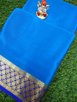 Mysore silk crape saree comes with over all body plain design with multi design gold border