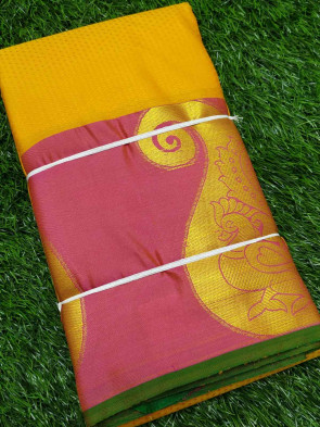 Half silk saree comes with over all body small tiny flower embose design with gold big mango peacock butta border