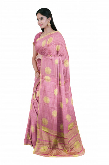 Raw silk saree comes with over all body round gold flower butta design with gold temple border
