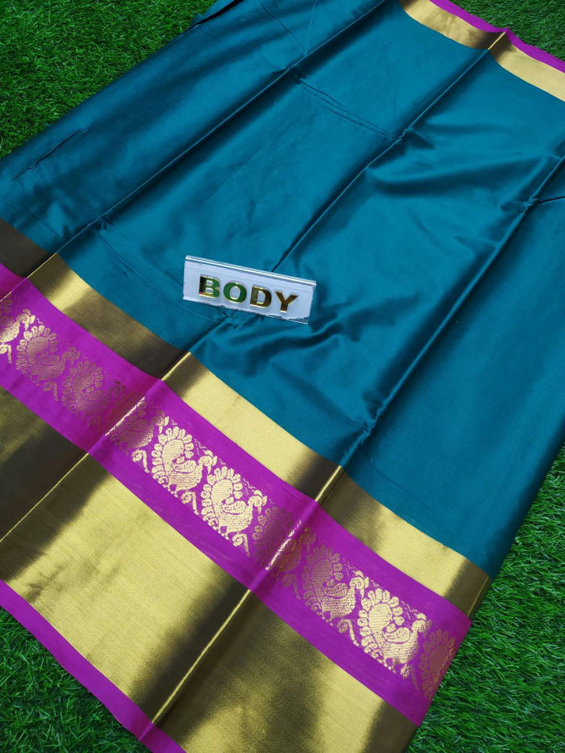 2c79ad8439 Soft cotton saree comes with over all body plain with gold peacock design  and gold big