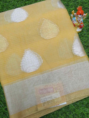 Raw silk saree comes with over all body printed flower butta design with silver plain border
