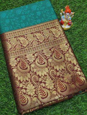 Art silk saree comes with over all body flower embose design with multi design gold border