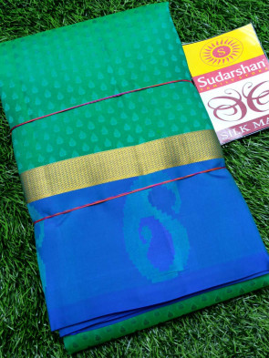 Kanchipuram silk saree comes with over all body small flower embose design with mango border
