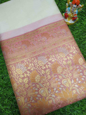Art silk saree comes with over all body plain design with gold flower butta border