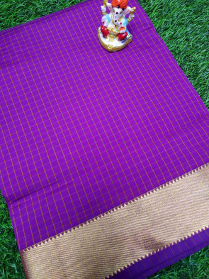 Cotton saree comes with over all body checks design with gold plain border
