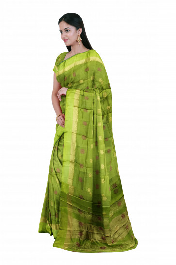 Raw silk saree comes with over all body small flower butta design with gold line and plain border