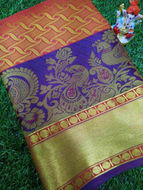 Art silk brocade saree comes with over all body small gold swasthik waves and big peacock butta design with gold plain border