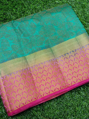 Raw silk saree comes with over all body flower embose design with gold leaf butta border