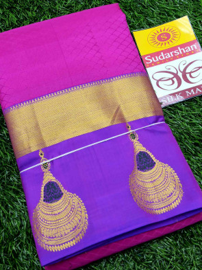 Kanchipuram silk saree comes with over all body lines embose design with gold ear ring butta gold border